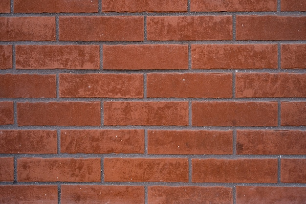 Brick wall. texture of red brick with gray filling Free Photo