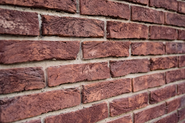 Brick wall. texture of red brick with white filling Free Photo