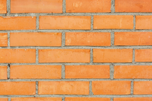 Brick wall with concrete and stones Free Photo