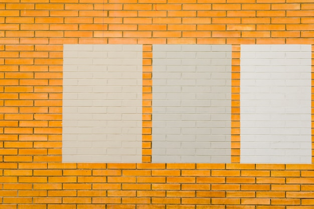 Brick wall with frames Free Photo