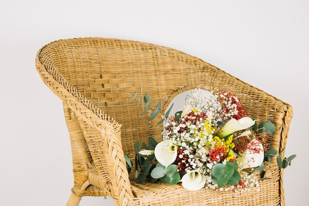 Bridal bouquet of flowers in an armchair Free Photo