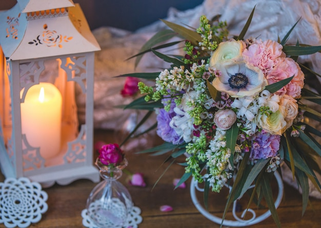 Bridal bouquet with candle and wedding stuff Free Photo