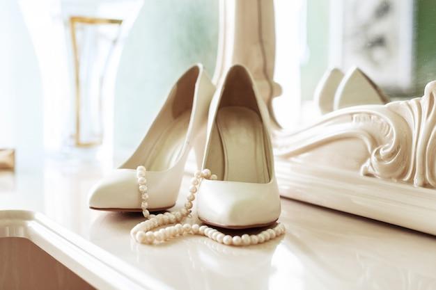 Bridal women shoes. the concept of wedding and celebration. Premium Photo