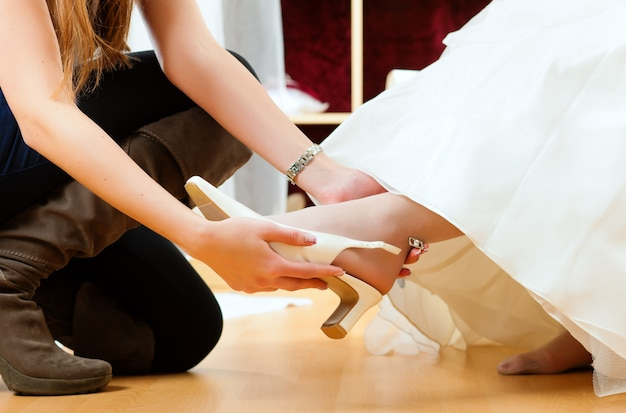 Bride at the clothes shop for wedding dresses Premium Photo