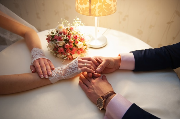 Bride and groom are sitting at a table in restaurant Premium Photo