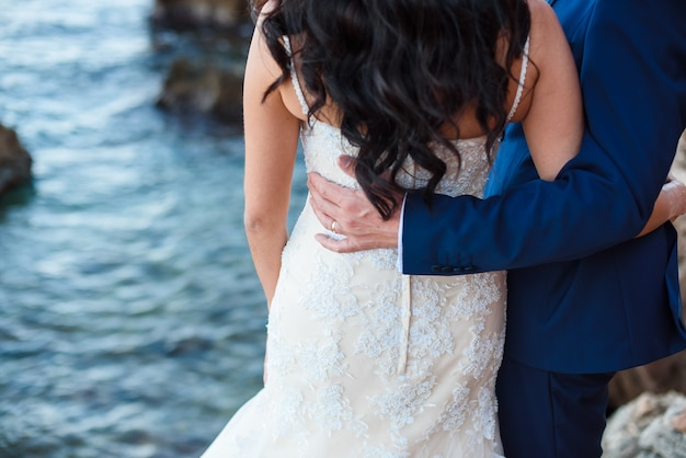 Bride and groom on the beach with a romantic moment Premium Photo