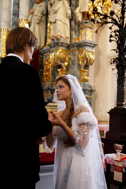 Bride and groom at the church Premium Photo