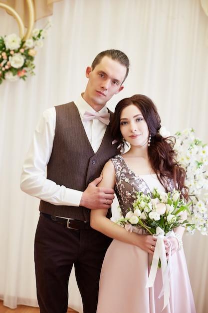 Bride and groom hug and pose for the wedding Premium Photo