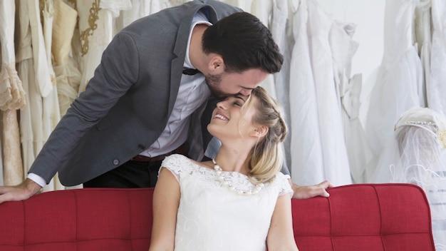 Bride and groom in wedding dress prepare ceremony. Premium Photo