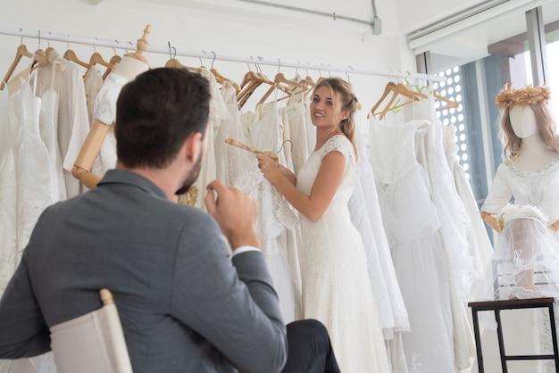 Bride groom in wedding dress in wedding ceremony. Premium Photo