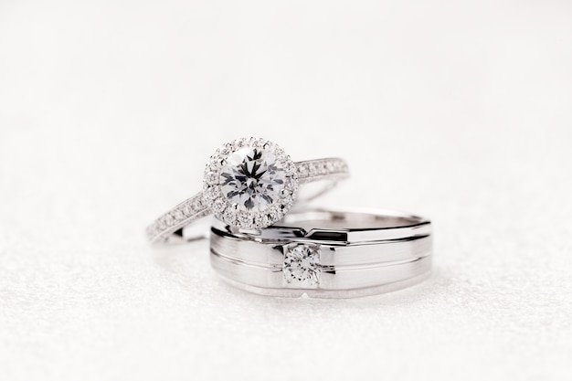 Bride and groom wedding engagement rings on white background Premium Photo