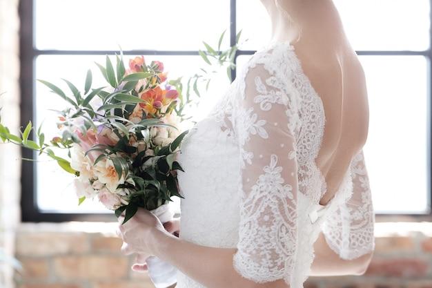 Bride in her wedding dress Free Photo