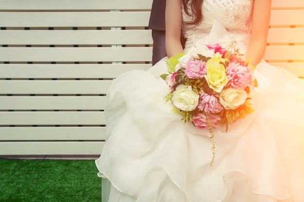 Bride holding a colorful bouquet Free Photo