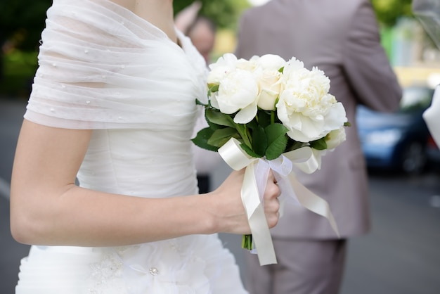 Bride holding wedding flowers bouquet Premium Photo