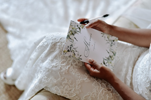 Bride is writing the wedding vows , wedding day symbols Free Photo