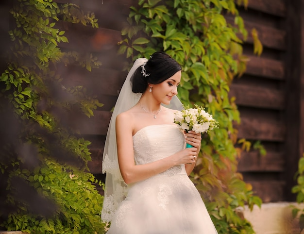 Bride looking her bouquet Free Photo