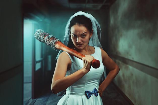 Bride maniac with baseball bat Premium Photo