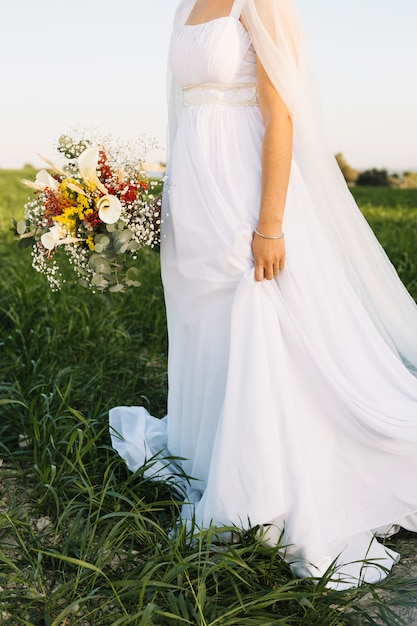 Bride in a natural landscape Free Photo