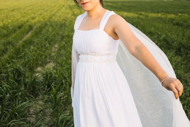 Bride in a natural landscape Free Photo