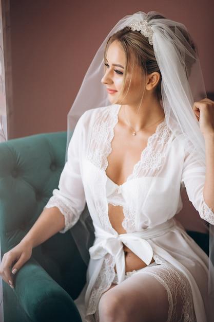 Bride preparing for wedding ceremony Free Photo