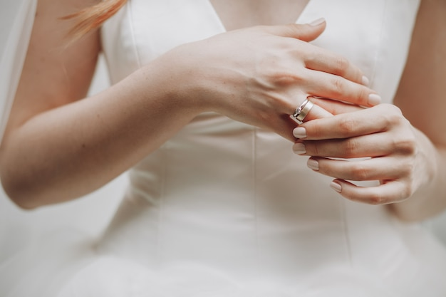 Bride touches her finger with wedding ring Free Photo