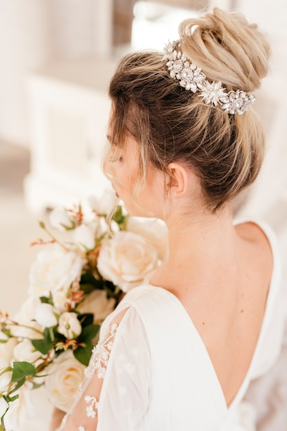 Bride with bouquet of flowers Free Photo