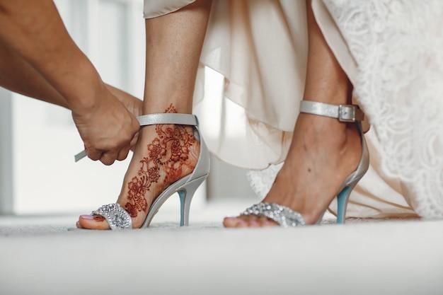 Bride with mehendi Free Photo