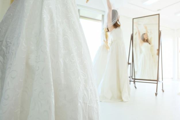 Bridesmaid dress rehearsal at the tailor shop. Premium Photo