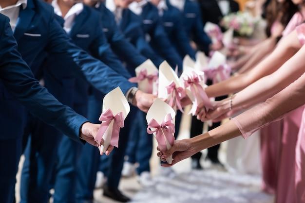 Bridesmaid holding a flower cone Premium Photo