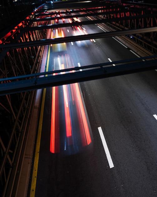 Bridge with motion blur traffic close-up Free Photo