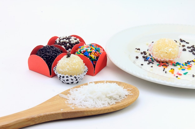 Brigadeiro (brigadier), chocolate sweet typical of brazilian cuisine covered with particles, in a white background Premium Photo
