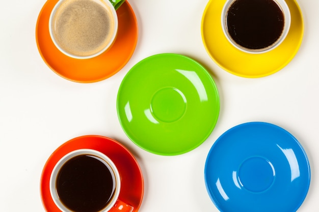 Bright colored composition of coffee cups Premium Photo