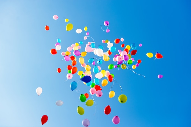 Bright colorful balloons over blue sky Premium Photo
