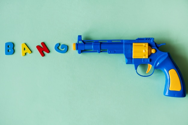 Bright and colorful plastic toy gun Free Photo