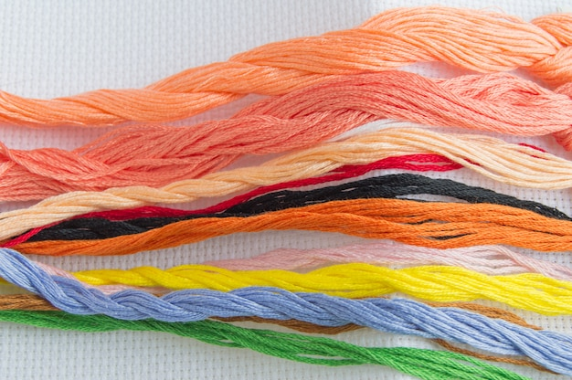Bright colorful thread for embroidery thread on canvas Premium Photo