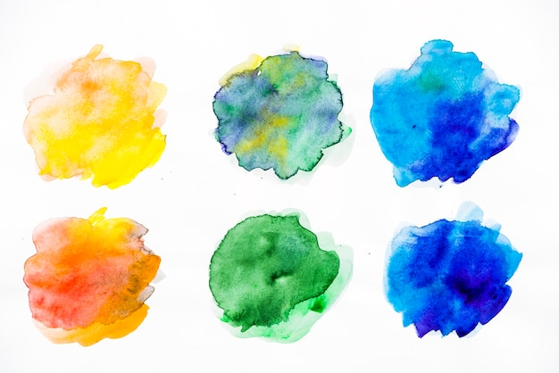 Bright colorful watercolor splatter on white background Free Photo