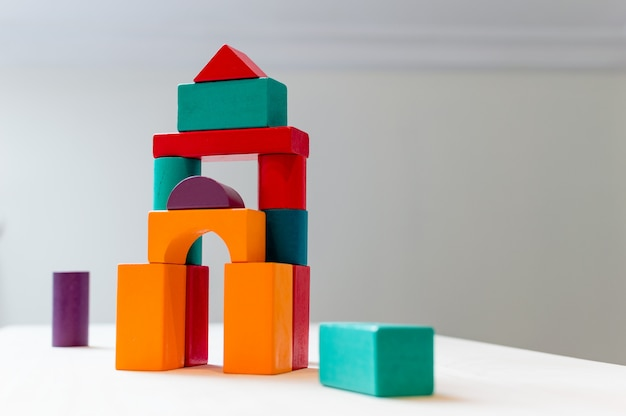 Bright colorful wooden blocks toy. bricks children building tower, castle, house. Premium Photo