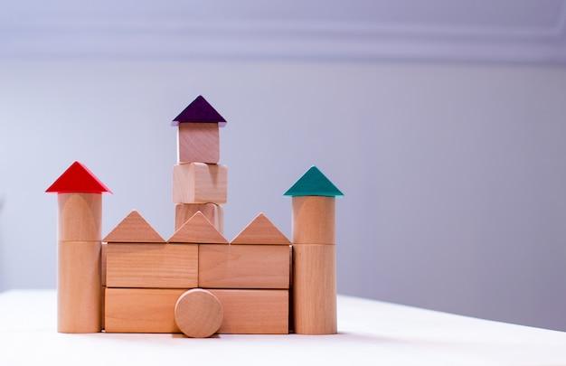 Bright colorful wooden blocks toy. bricks children building tower, castle, house. Premium Photo