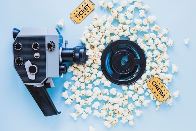 Bright composition of camera and popcorn Free Photo