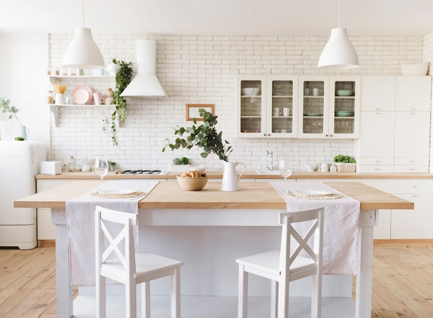 Bright cosy modern kitchen with island Premium Photo