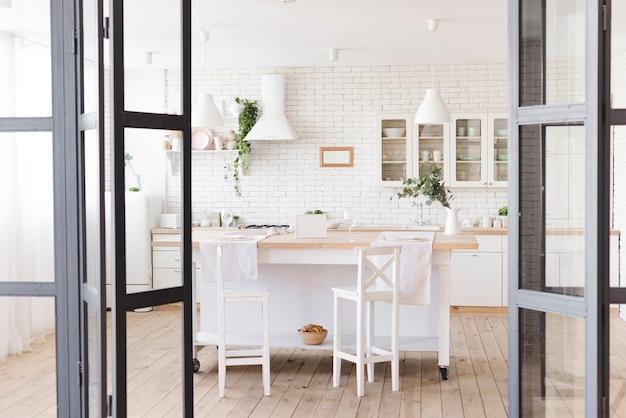Bright cosy modern kitchen with island Free Photo