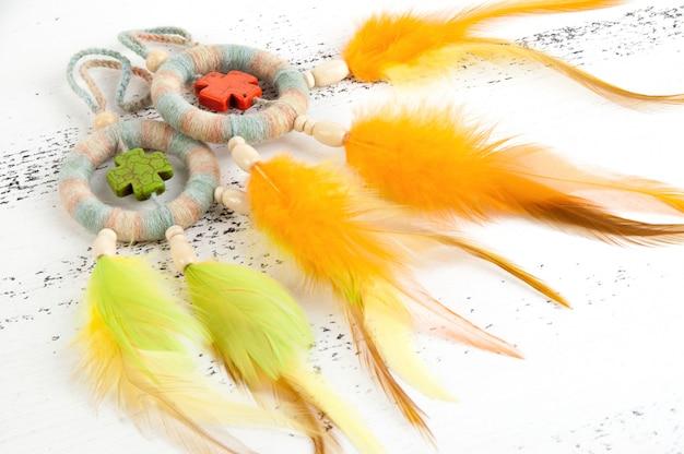 Bright dream catchers with orange and green crosses Premium Photo
