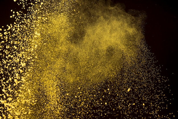 Bright dust of makeup powder on dark background Free Photo