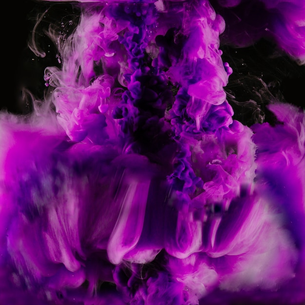 Bright explosion of purple ink Free Photo