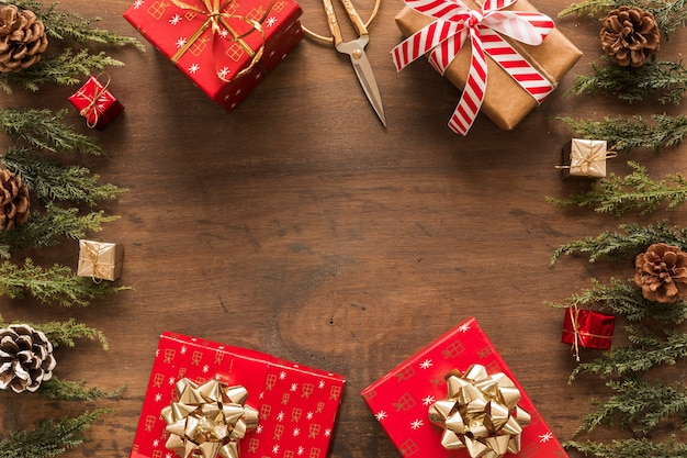 Bright gift boxes with green branches Free Photo