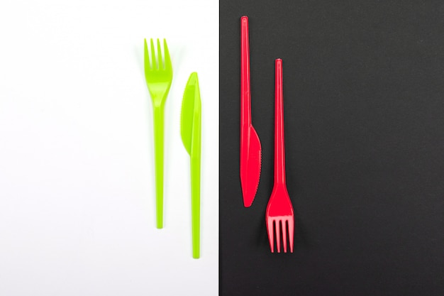 Bright green and red forks isolated on black and white background Premium Photo