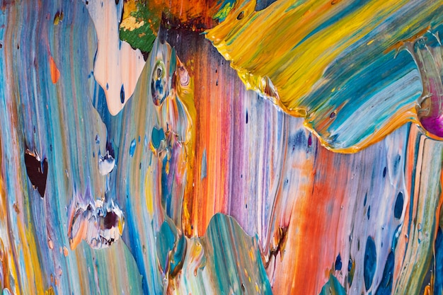 Bright, juicy, multi-colored abstraction of their mixing of oil paints on a palette close-up. Premium Photo