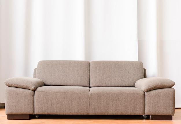 Bright minimalist living room with comfortable sofa Premium Photo