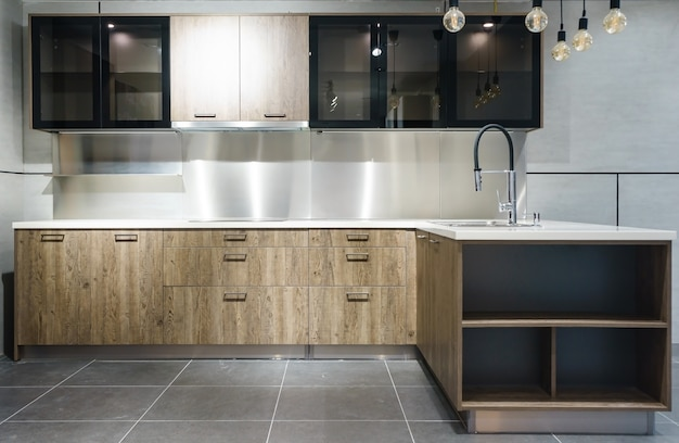 Bright modern kitchen with stainless steel appliances. interior design. Premium Photo