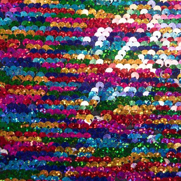 Paillettes multicolori luminosi sullo sfondo Foto Gratuite